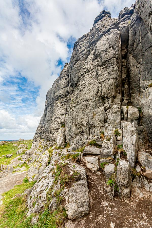 Rocky limestone plateau in the Burren. Cappanwalla mountain, Geopark and Geosites, Wild Atlantic Way, spring day in County Clare in Ireland royalty free stock images