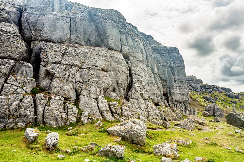 Rocky limestone plateau landscape in Caher valley and Black Head. Geopark and Geosites, Wild Atlantic Way, cloudy spring day in County Clare in Ireland royalty free stock photo