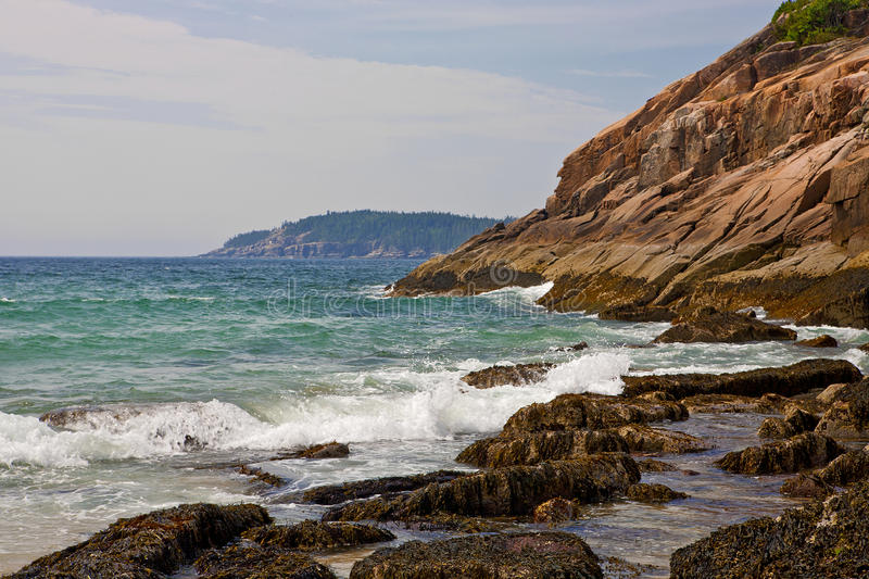 The Rocky Maine Coast. Waves pound the rocky Maine coast at Acadia National Park stock photo