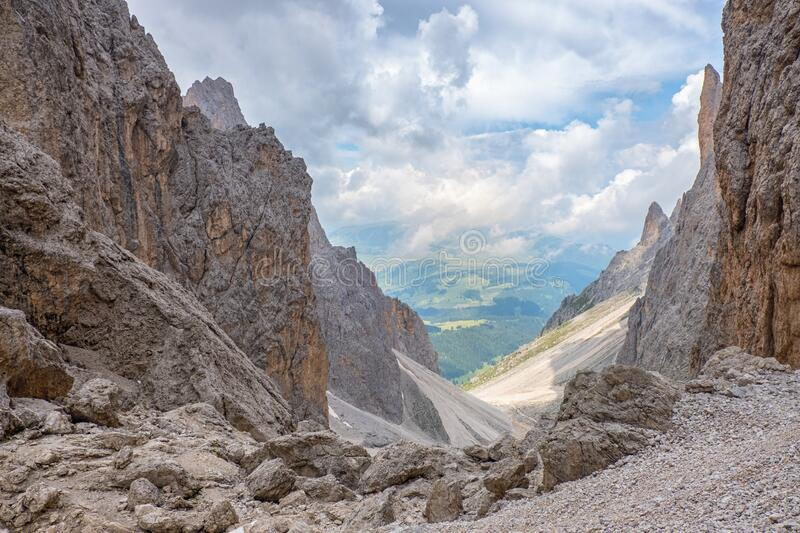 Rocky mountain canyon with a scenic view to a valley in the alps stock image