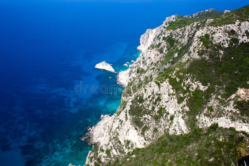 Rocky mountain coast bay aerial view. Beautiful landscape. Blue clear ocean sea water next to cliff in Corfu Greece. Travel and ad. Rocky mountain coast bay royalty free stock photos