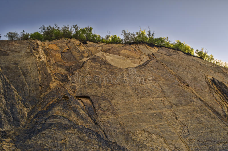 Rocky mountain with cracks and fissures in sunny weather at Lahic Big Caucasus Mountains of Azerbaijan. Close up royalty free stock images