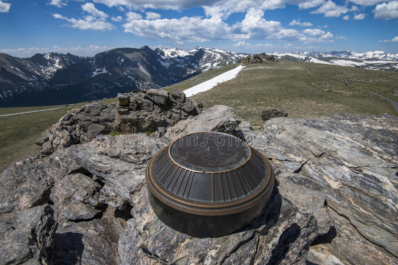 Rocky Mountain National Park. A bronze plaque at the top of the highest point of Trail Ridge Road that goes through the Rocky Mountain National Park, Colorado royalty free stock photo