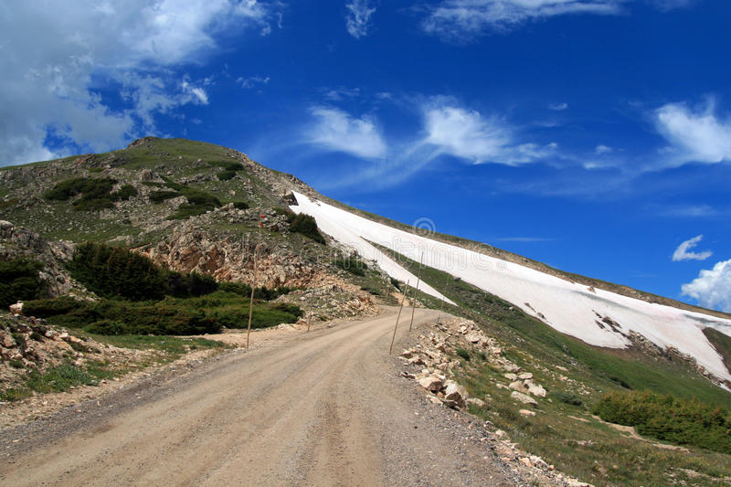 Rocky Mountain National Park in the spring / summer. The gravel dirt road to the top of Rocky Mountain National Park Colorado USA stock images