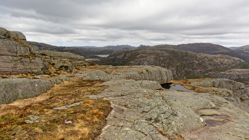 Rocky mountain plateau in Rogaland, Norway. Barren rocky mountain plateau on a cloudy day in Rogaland, Norway royalty free stock photos