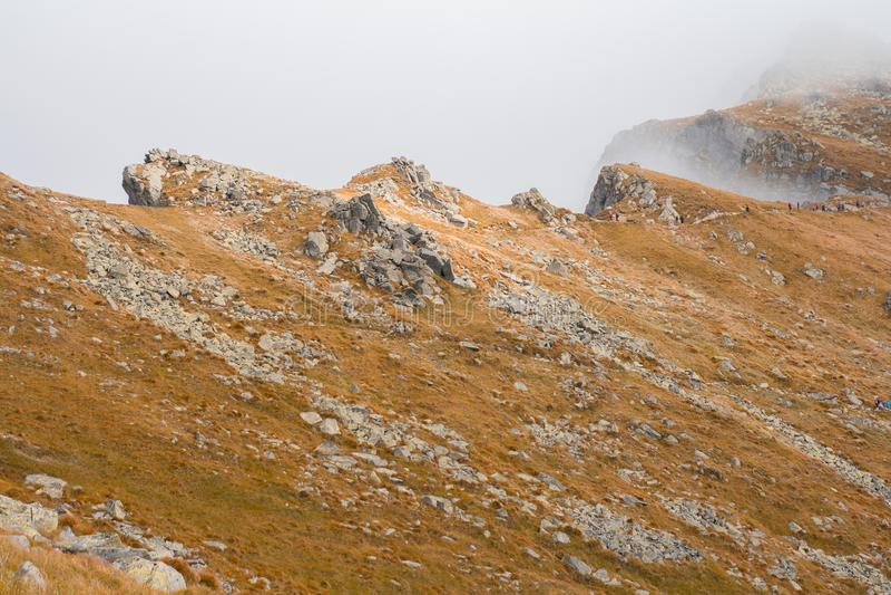 Mountain ridge in fog. Rocky mountain ridge in fog stock photos