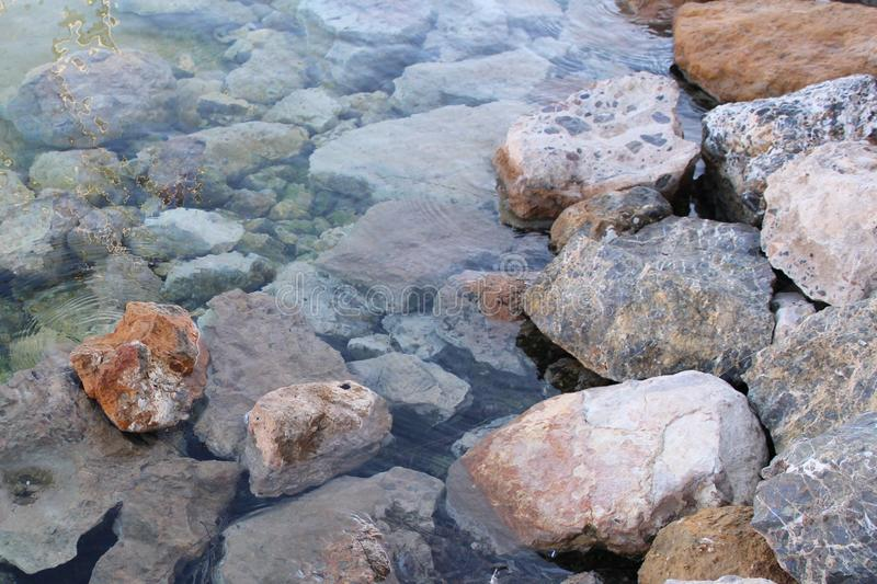 Rocky mountain on the seashore stock photo