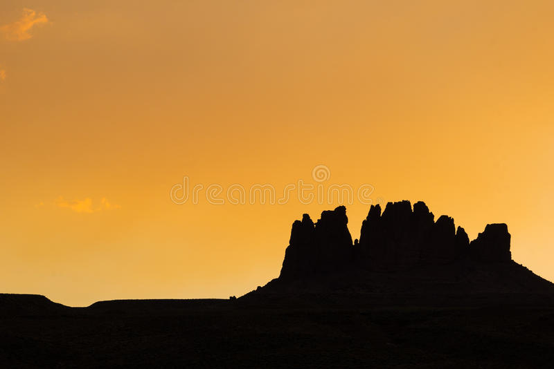 Rocky silhouette of mountain in sunset. Rocky Mountain silhouette and horizon under an orange sky t sunset stock photography