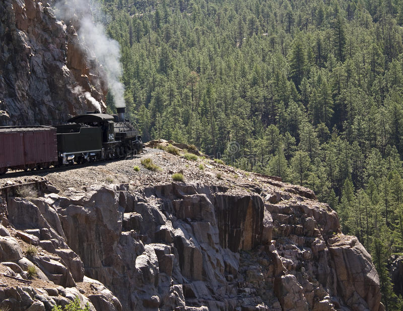 Rocky mountain train. Steam locomotive on a high narrow gauge railroad track in the Rocky Mountains, Colorado, USA royalty free stock photo
