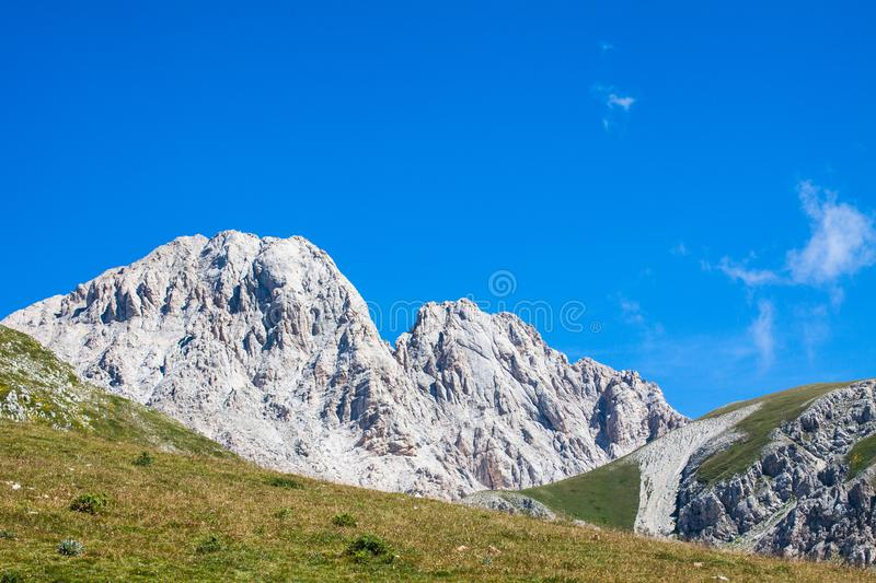 Rocky mountains of the Abruzzi National Park in summer between the green of the Italian Apennines. Spectacular nature stock photos