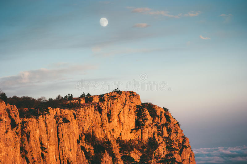 Rocky Mountains cliff and moon sunset Landscape. Travel aerial view serene scenery wild nature royalty free stock photography