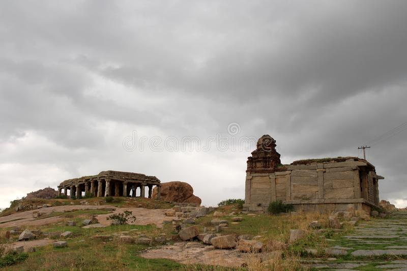 The rocky mountains and hills surrounding temples in Hampi stock photos