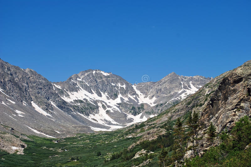 Rocky Mountains in July stock photography
