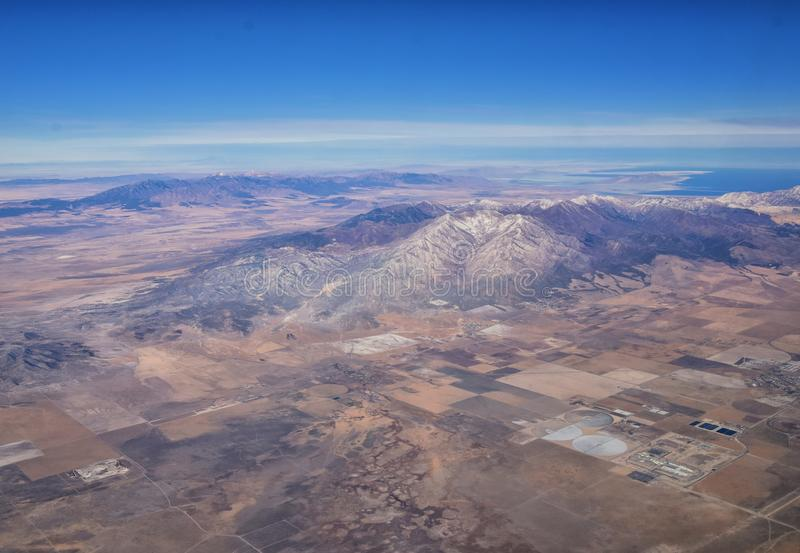 Rocky Mountains, Oquirrh range aerial views, Wasatch Front Rock from airplane. South Jordan, West Valley, Magna and Herriman, by t. He Great Salt Lake Utah stock photo