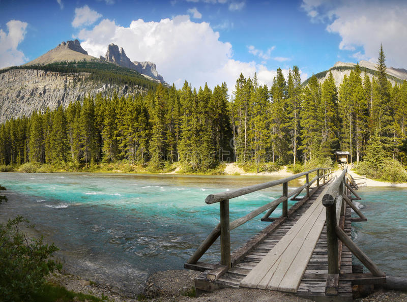 Rocky Mountains Trail, Canada. Bridge over the river. Rocky Mountains trail, Jasper, Canada stock photography