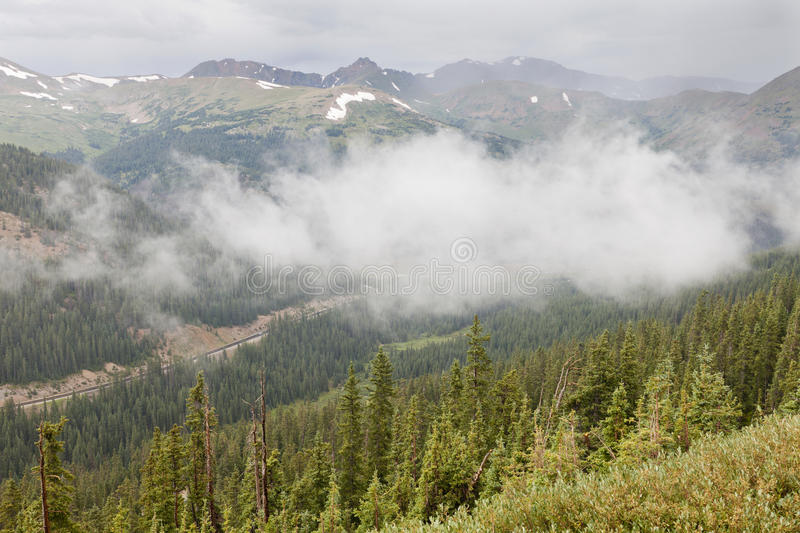 Rocky Mountains valley. Colorado Rocky Mountains valley in fog and low clouds - a late summer view from the Loveland Pass stock photography