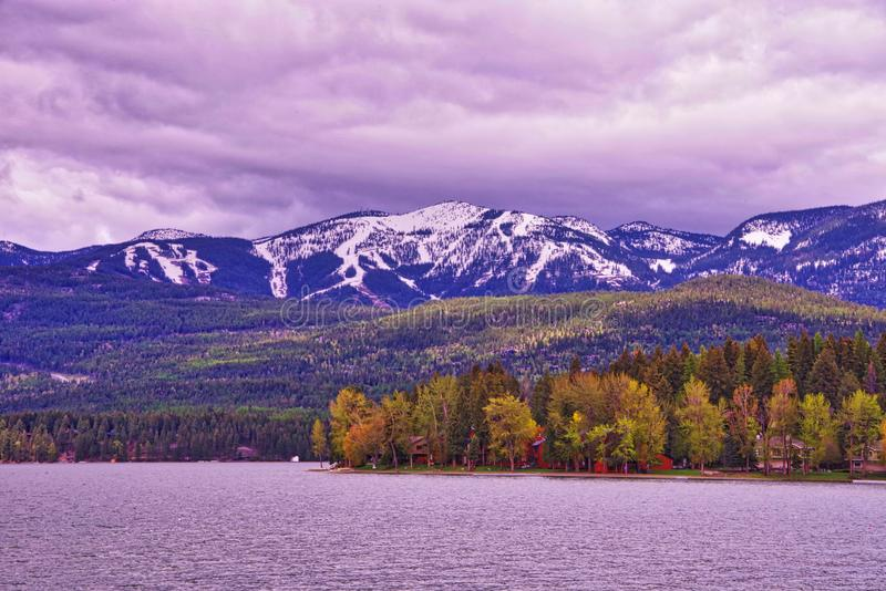 Rocky mountains and Whitefish lake. Rocky mountains in the distance with the Whitefish lake on the foreground in Montana, USA stock images