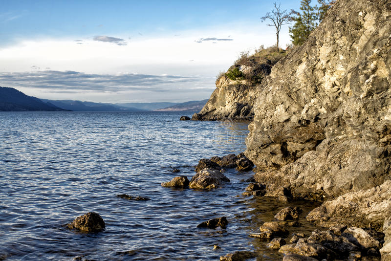 Rocky Okanagan Lake shore stock photo