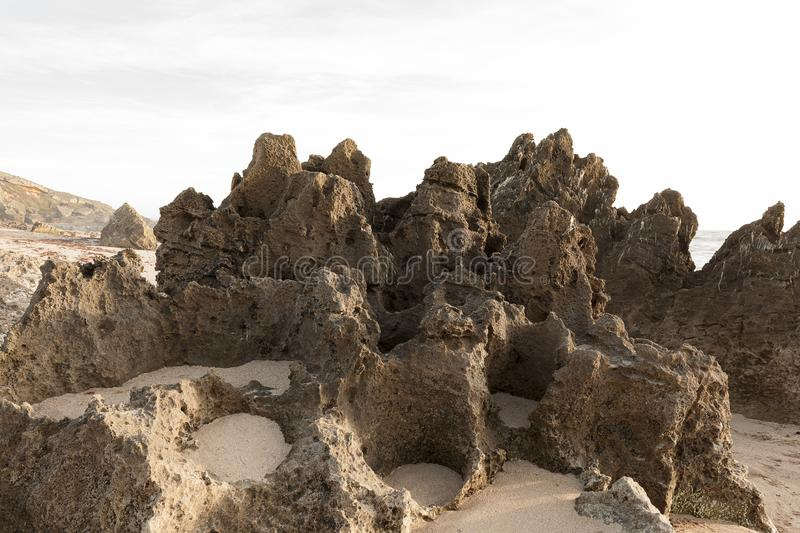 Rocky outcrop on a beach, forming this natural stone. Monument located south of Sines in Portugal, Europe stock images