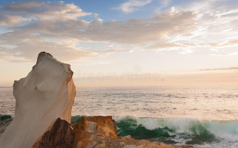 Rocky outcrop over the pacific ocean royalty free stock image