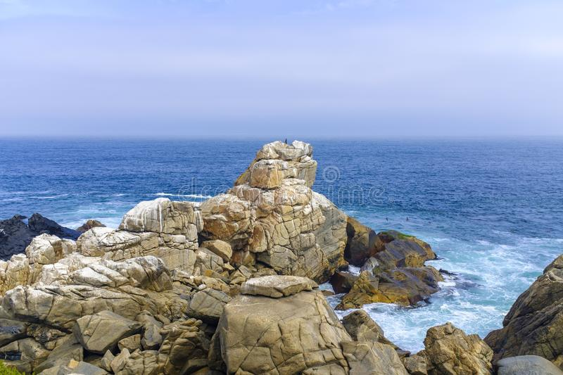Rocky Pacific coastline near Valparaiso. Chile, on a cold autumn day royalty free stock photo