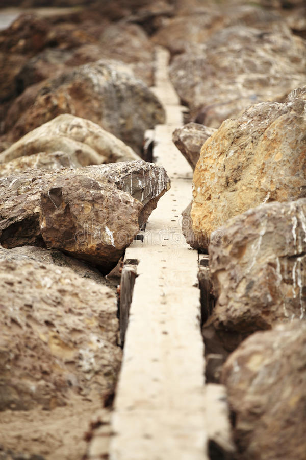 Rocky Pathway. Symbol of difficulties on the way. Uphill battle stock image