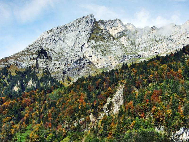 Rocky peak Ochsenchopf in the Glarus Alps Mountain Range and above Lake Klontalersee. Canton of Glarus, Switzerland royalty free stock photos