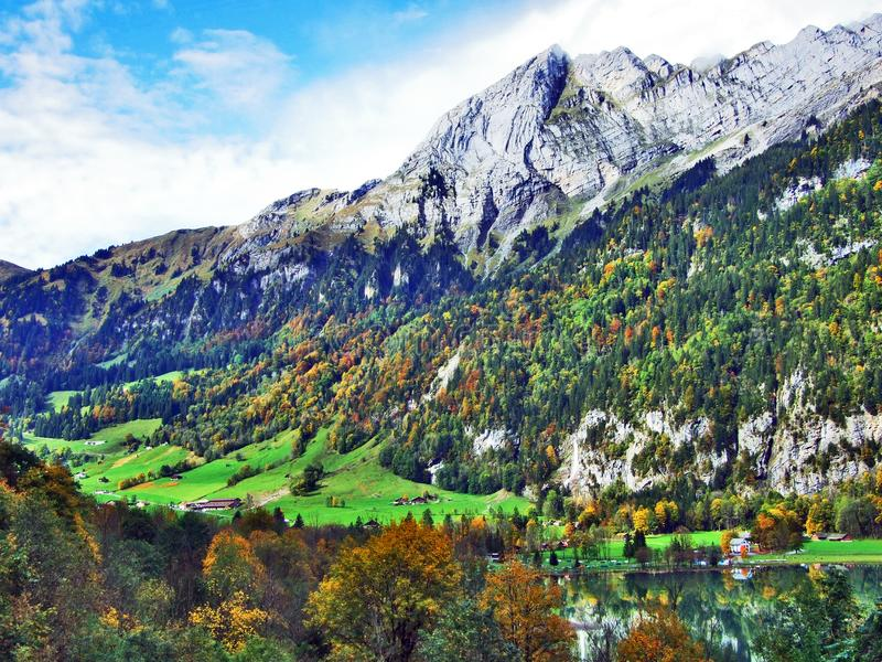 Rocky peak Ochsenchopf in the Glarus Alps Mountain Range and above Lake Klontalersee. Canton of Glarus, Switzerland royalty free stock images