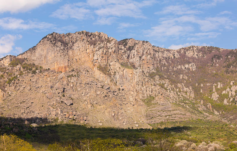 Rocky ridge with crumbled slope inaccessible high mountain. Walk stock images