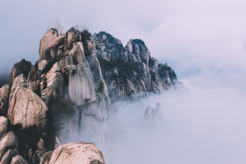 Rocky ridge in fog royalty free stock photography