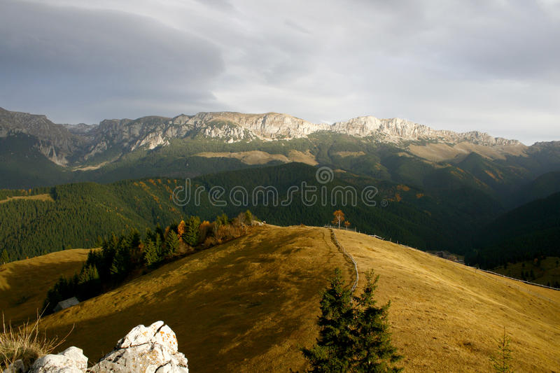 Rocky ridge under heavy sky at sunset royalty free stock images
