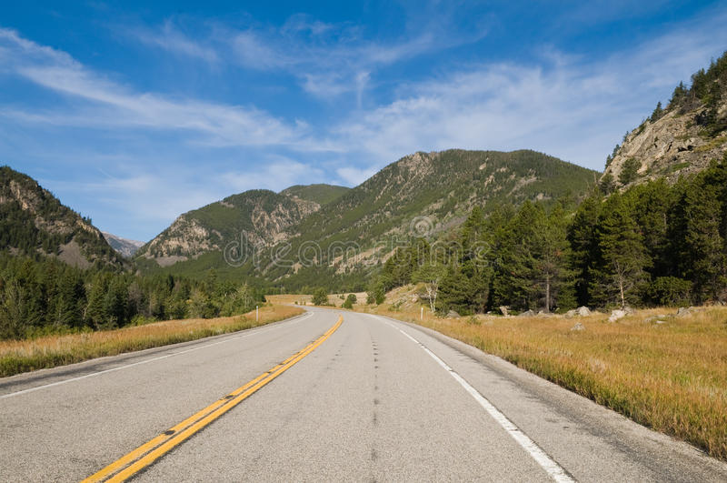 Download Rocky road stock image. Image of highway, mountains, grass - 10977267