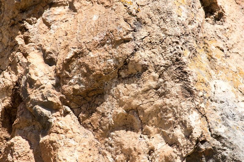 Rocky rock as background. Photo of an abstract texture royalty free stock photography