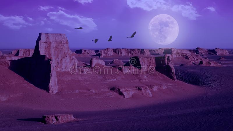 Rocky sandstone formations in the Dasht e Lut desert against the sky with moon. Nature of Iran. Persia. Image toned pink and violet color royalty free stock image