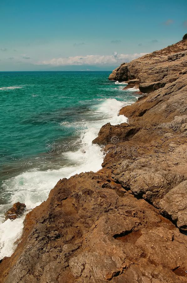 Rocky sea coast of Balearic sea in Spain. Beautiful summertime outdoor background royalty free stock photo