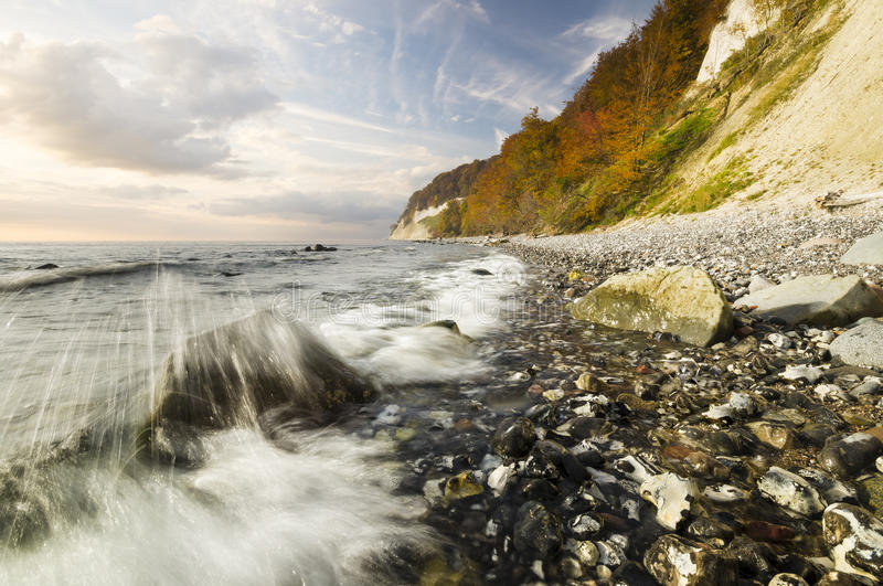 Rocky sea coast, in the light of the rising sun royalty free stock images