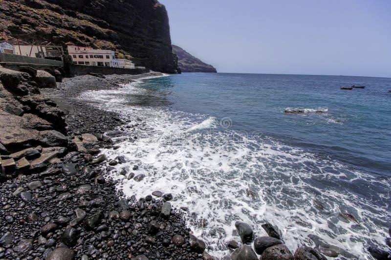 The rocky sea coastline in the destroyed village La Dama stock photography