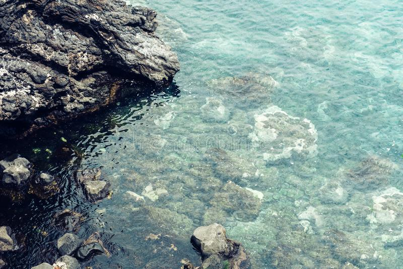 Rocky sea shore of Acitrezza next to Cyclops islands, Catania, Sicily, Italy.  royalty free stock images