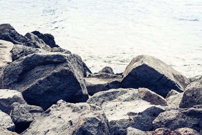 Rocky sea shore of Acitrezza next to Cyclops islands, Catania, Sicily, Italy.  royalty free stock image