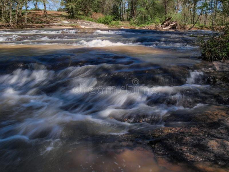 Rocky Shoals above Carter Falls. Water cascades over a series of rocky shoals above Carter Falls near Elkin, North Carolina stock image