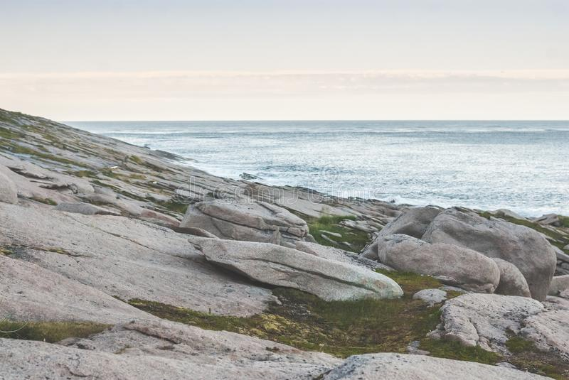 A rocky shore of the Barents Sea, the island of Mageroya, Norway. A rocky shore of the Barents Sea, Mageroya island, Norway royalty free stock photos
