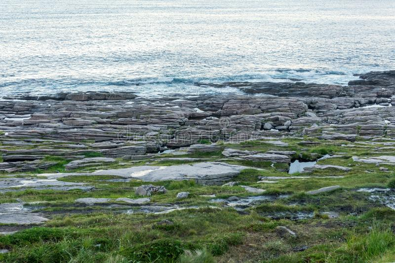 A rocky shore of the Barents Sea, the island of Mageroya, Norway. A rocky shore of the Barents Sea, Mageroya island, Norway royalty free stock photo