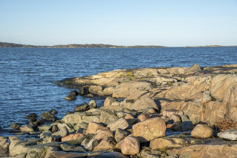Rocky shore in Gothenburg in Sweden. Rocky shore by the sea in Gothenburg in Sweden royalty free stock images