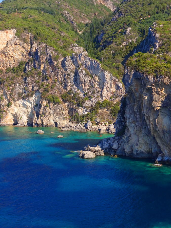 The rocky shore of the island of Corfu Greece royalty free stock photo