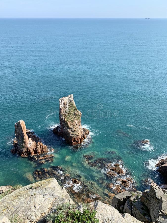 The rocky shore of the island of Shkot  in spring. Russia, Vladivostok.  stock photography