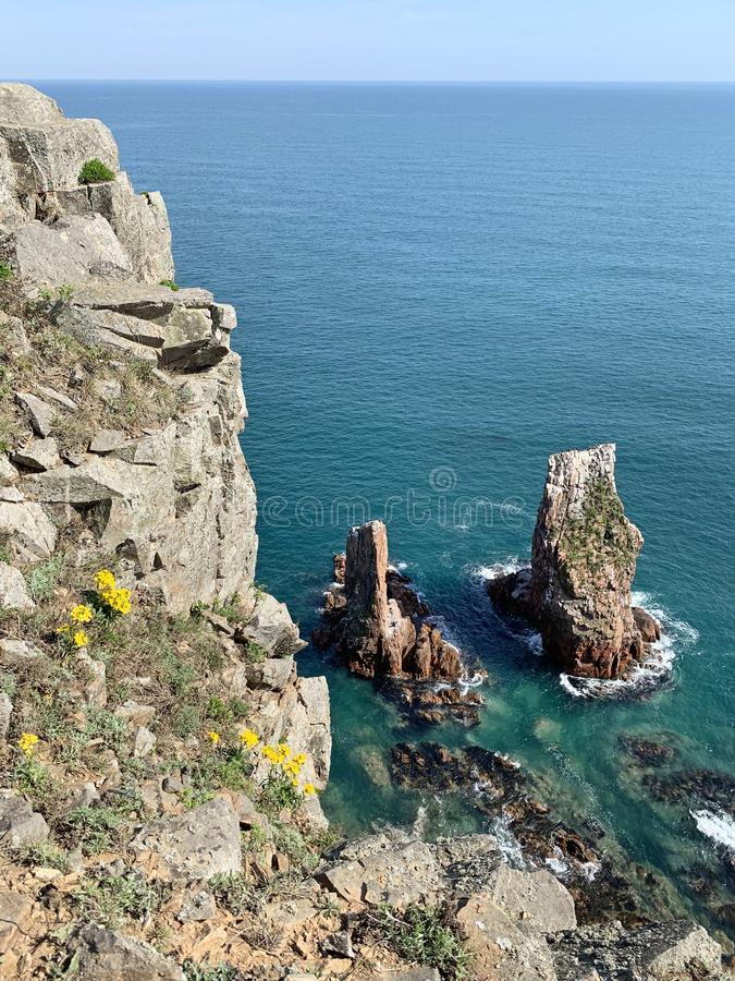 The rocky shore of the island of Shkot  in spring. Russia, Vladivostok.  royalty free stock photography