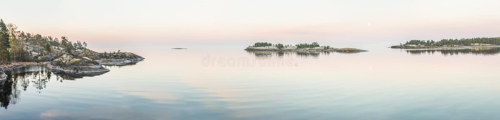 Rocky shore of the lake on a sunny day. stock photo