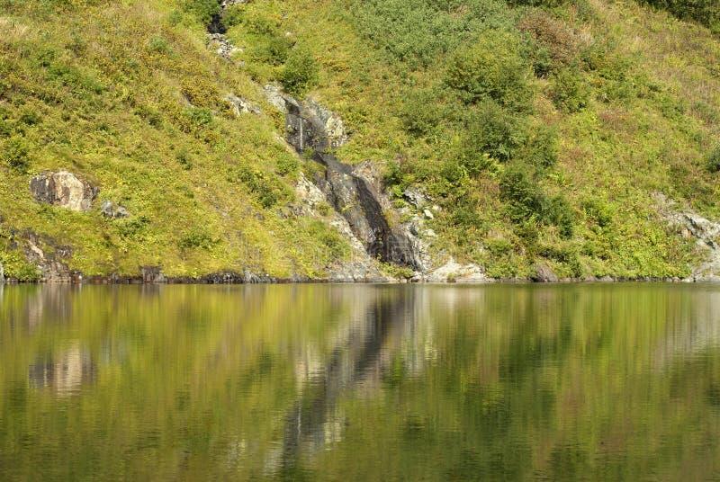 Rocky shore of a mountain lake stock photography