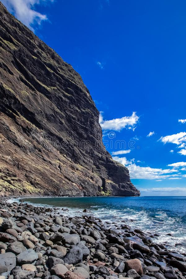 Rocky cape protrudes into the sea, ocean coast, pebbles, seascape, good weather stock photos