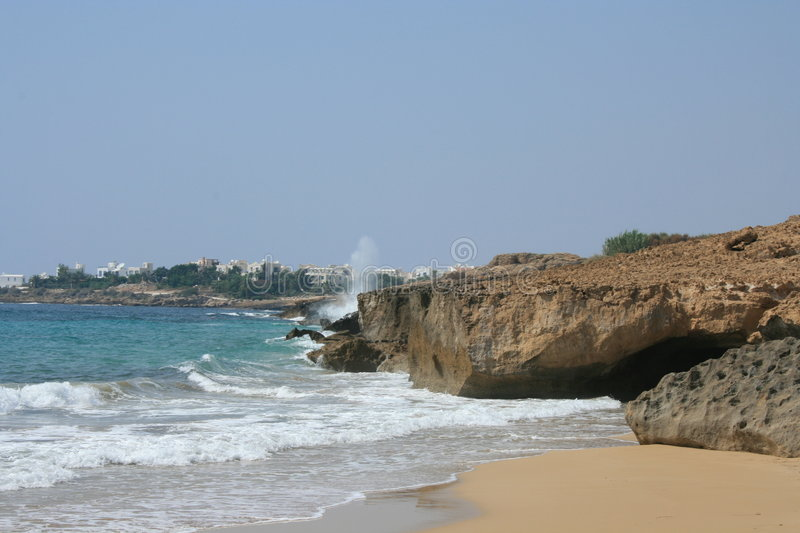 A rocky shore in Paphos stock photography